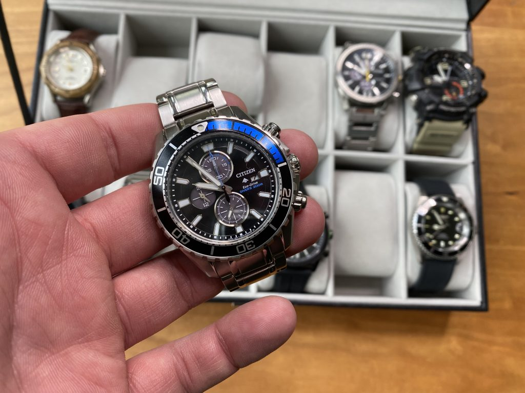 Holding up a watch to check the time for a time study